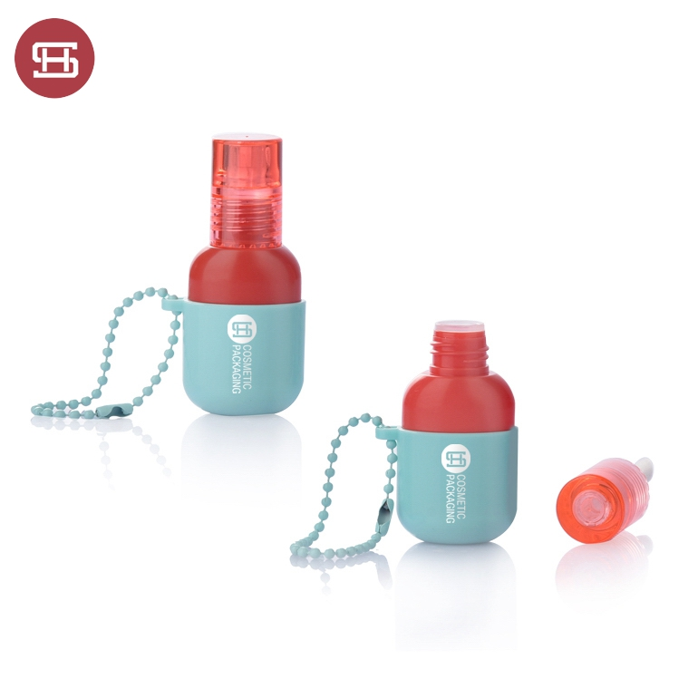 9882# New Unique Red Color Cap and  Blue Base With Hanging Chain Plastic Empty  Lip Gloss Bottle Featured Image